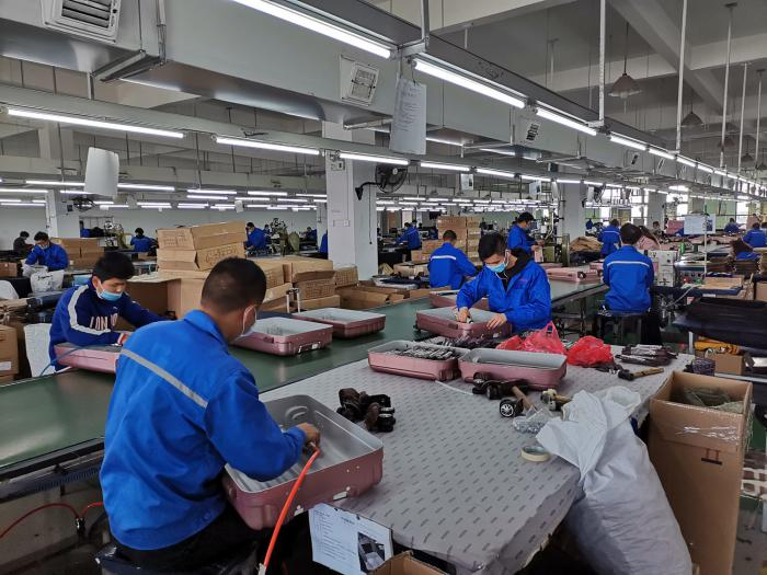 Victorlite Busy luggage assembling line and hard-working staffs